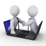 Businessmen handshake through laptop Stock Photo