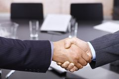 Businessmen handshake over table Royalty Free Stock Photos