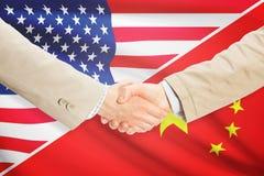 Businessmen handshake - United States and China Royalty Free Stock Images