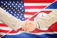 Businessmen handshake - United States and North Korea Stock Images