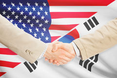 Businessmen handshake - United States and South Korea. Businessmen shaking hands - United States and South Korea Royalty Free Stock Photo