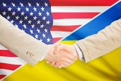 Businessmen handshake - United States and Ukraine Royalty Free Stock Image