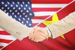 Businessmen handshake - United States and Vietnam Royalty Free Stock Photos