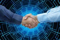 Businessmen Handshaking closeup focused technology background. Businessmen Handshaking closeup against focused technology background Royalty Free Stock Images