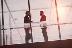 Businessmen handshaking stock photography