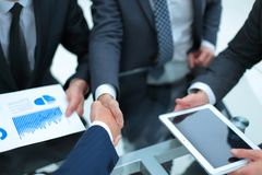 Business handshake. Business handshake and business people conce. Businessmen handshaking after signing contract Stock Images