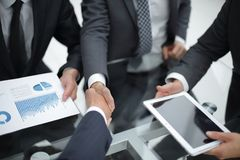Business handshake. Business handshake and business people conce. Businessmen handshaking after signing contract Royalty Free Stock Photography