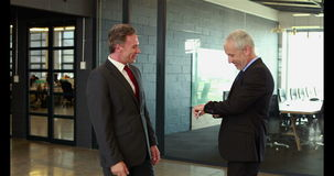 Businessmen handshaking and talking stock video footage