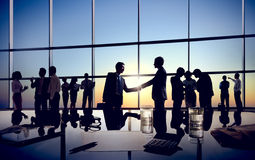 Businessmen Handshaking with Their Colleagues Royalty Free Stock Photo