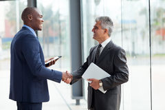 Businessmen handshaking Stock Photography