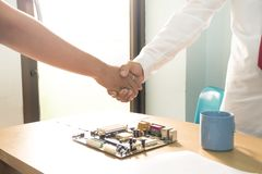 Businessmen have joined hands to do business together stock images