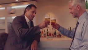 Businessmen having a beer together stock video