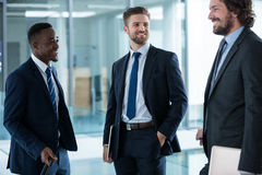 Businessmen having a conversation Stock Photo