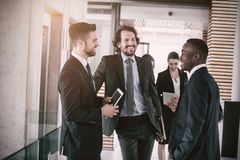 Businessmen having conversation Stock Images
