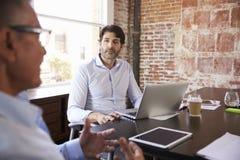 Businessmen Having Creative Brainstorming Meeting In Office Stock Images