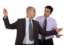 Businessmen having a disagreement Stock Photo
