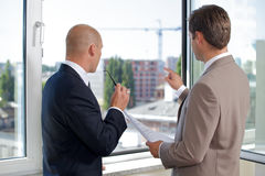Businessmen having discussion at office Stock Photos