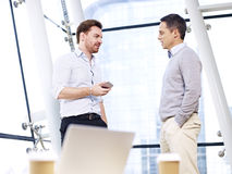 Businessmen having a discussion in office Royalty Free Stock Image