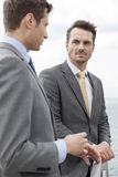 Businessmen having a discussion on terrace Royalty Free Stock Photos