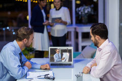 Businessmen having video conference Stock Image