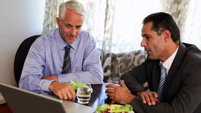 Businessmen having a working lunch Royalty Free Stock Photography