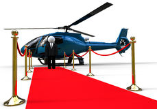 Businessmen with a helicopter on a red carpet Royalty Free Stock Photo