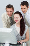 Businessmen helping a businesswoman. Royalty Free Stock Photo