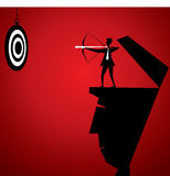 Businessmen hit the archery board. Stock Royalty Free Stock Photo