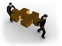 Businessmen hold gold puzzle Royalty Free Stock Image