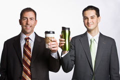 Businessmen holding coffee cups Royalty Free Stock Photos