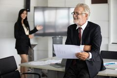 Businessmen holding documents for business partners discussing and share ideas at meeting and business women smiling happy for royalty free stock photo
