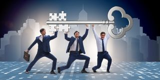 The businessmen holding giant key in business concept Stock Photos