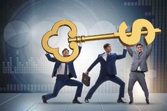The businessmen holding giant key in finance concept. Businessmen holding giant key in finance concept Stock Photos