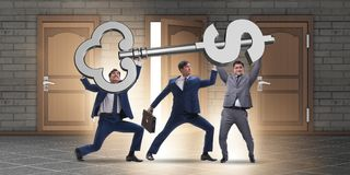 The businessmen holding giant key in finance concept. Businessmen holding giant key in finance concept Royalty Free Stock Photography