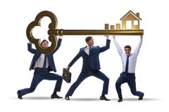 The businessmen holding giant key in real estate concept. Businessmen holding giant key in real estate concept Royalty Free Stock Photos