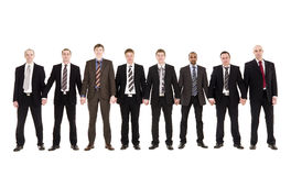 Businessmen holding hands Royalty Free Stock Photos