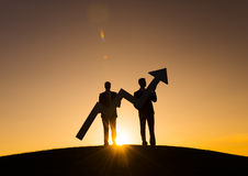 Businessmen holding the increase graph on the hill Royalty Free Stock Photos