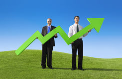 Businessmen Holding Increase Graph Landscape Concept Royalty Free Stock Image