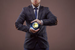 Businessmen holding a model of the Earth. Royalty Free Stock Images