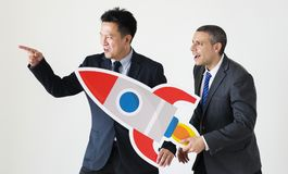 Businessmen holding a rocket icon Stock Image