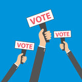 Businessmen holding a signboard with the word vote. A lot of hands hold placards,  vector. Businessmen holding a signboard with the word vote. A lot of hands Royalty Free Stock Photos