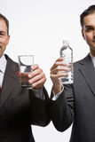 Businessmen holding water Royalty Free Stock Photo