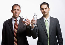 Businessmen holding water Royalty Free Stock Image
