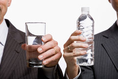Businessmen holding water Royalty Free Stock Photography