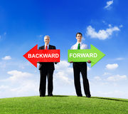 Businessmen Holding Word Backward and Forward Stock Images