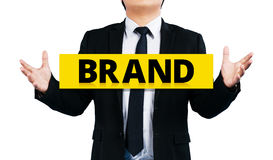 Businessmen holding the yellow label concept brand. isolated Stock Images