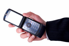 Businessmen holds mobile phone. The screen is cut with clipping path Royalty Free Stock Image