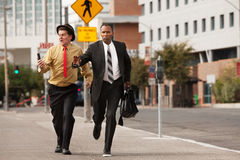 Businessmen In A Hurry Stock Photo