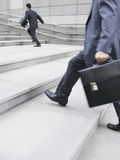 Businessmen Hurrying Up Steps Outdoors Royalty Free Stock Photography
