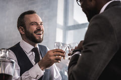 Free Businessmen In Formal Wear Clinking Whiskey Glasses And Talking Stock Image - 94662151